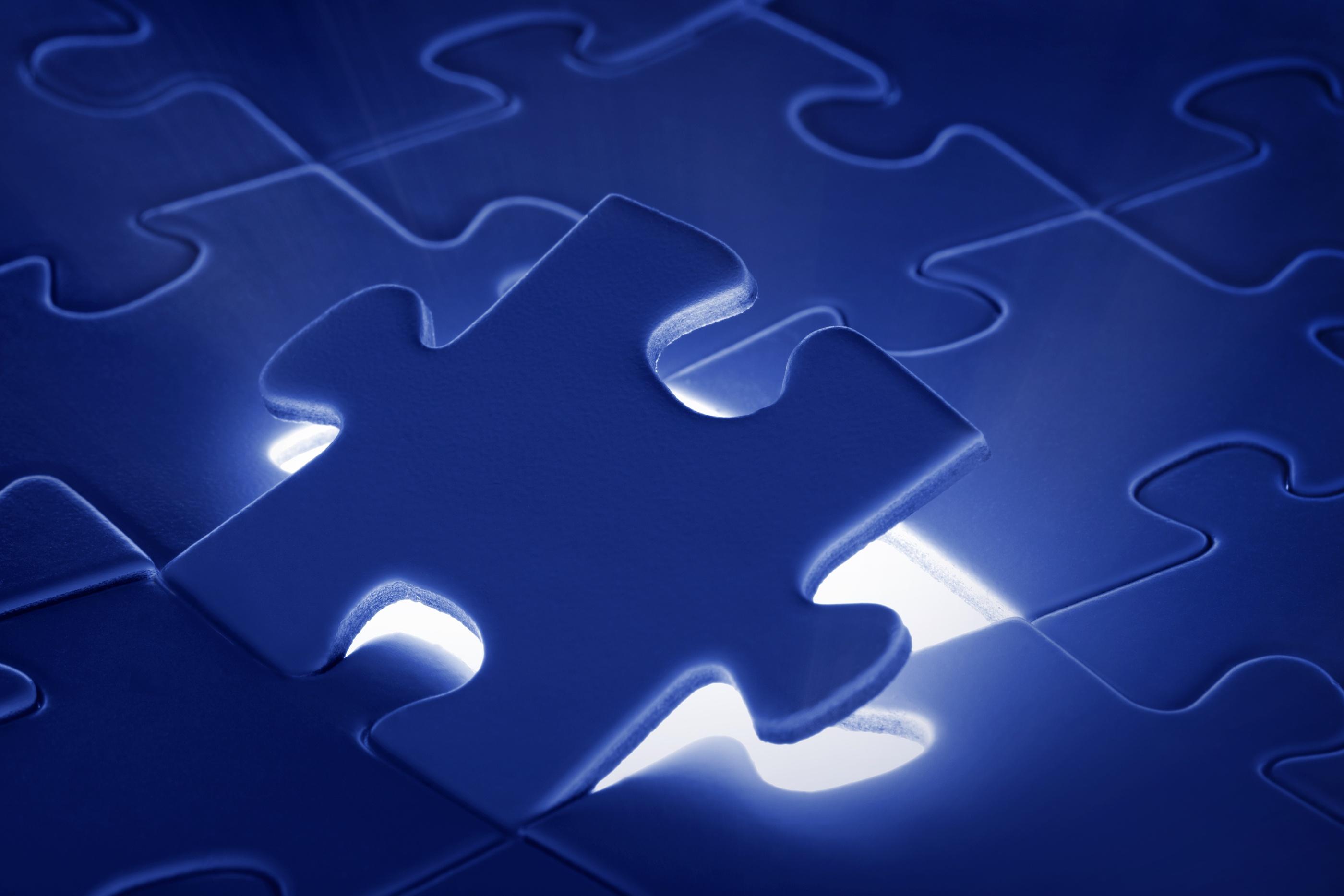 bigstock-Puzzle-Piece-Coming-Down-Into--8823280